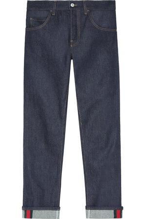 Gucci Dunkelblaue Jeans mit abgeschrägtem Bein und Webstreifen