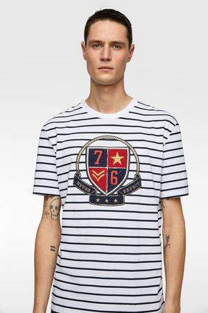 Zara Gestreiftes shirt mit aufnäher