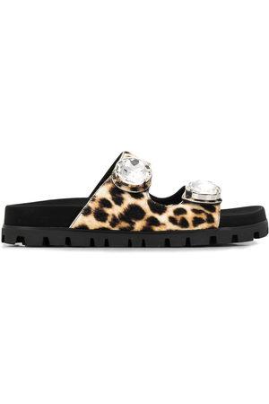 Miu Miu Verzierte Pantoletten mit Leopardenmuster