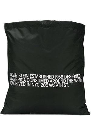 Calvin Klein Handtasche mit Slogan-Print