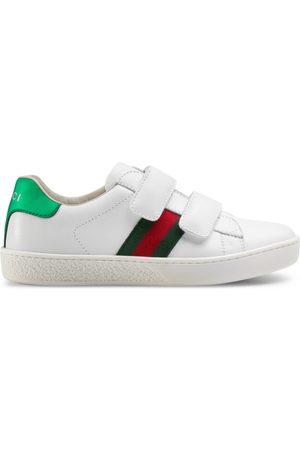 Gucci Kinder Ace Sneaker aus Leder mit Webstreifen