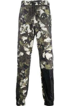 MARCELO BURLON Hose mit Camouflage-Print