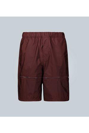 Prada Men Exklusiv bei Mytheresa – Wide-Leg Shorts
