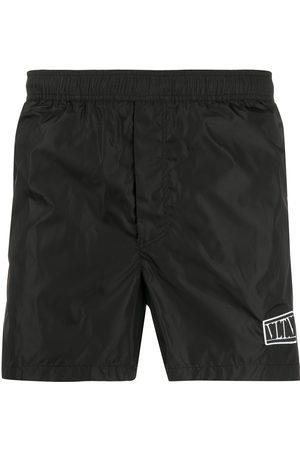 VALENTINO VLTN print swim shorts