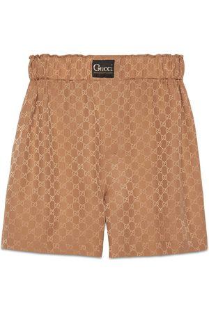 Gucci Damen Shorts - Shorts aus Seide mit GG und Etikett