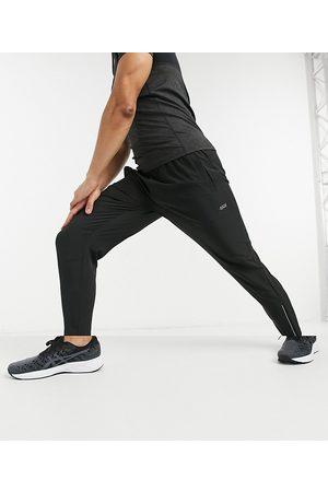 ASOS – Enge Lauf-Jogginghose aus Webstoff mit Karottenschnitt und reflektierenden Reißverschlüssen