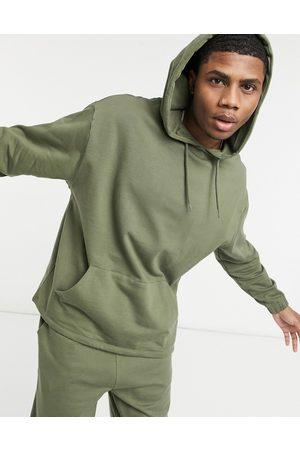 ASOS – Trainingsanzug in Khaki aus Bio-Baumwolle mit Oversize-Kapuzenpullover und -Jogginghose