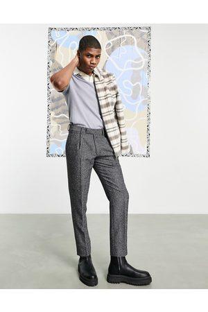 adidas – Schmale Hose aus Wollgemisch mit verstellbarem Riemen hinten und schwarzem Fischgrätenmuster