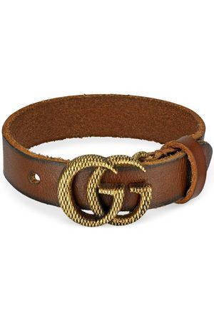 Gucci Damen Uhren - Armband aus Leder mit gravierter Doppel G Schnalle