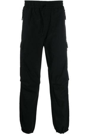 Carhartt Jogginghose mit aufgesetzter Tasche