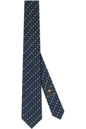 Gucci Krawatte aus Seide mit GG und Blumen