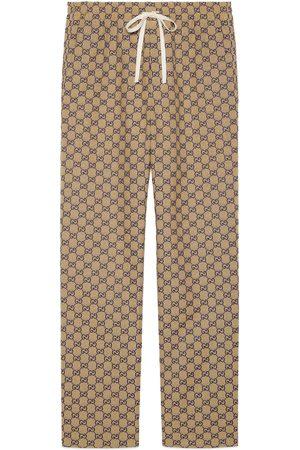 Gucci Hose aus GG Canvas mit GG aus Leder