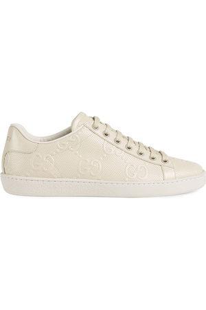 Gucci Damen Sneakers - Ace GG embossed low-top sneakers