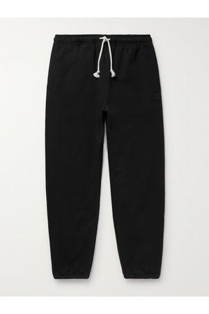 Acne Studios Tapered Logo-Appliquéd Loopback Cotton-Jersey Sweatpants