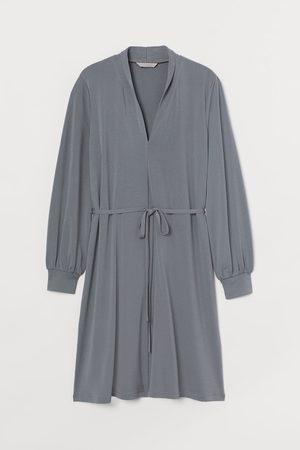 H&M Damen Midikleider - Kleid mit Schalkragen