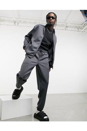 ASOS – Oversize-Trainingsanzug mit Jacke & Jogginghose in anthrazitfarbenem Neopren-Look