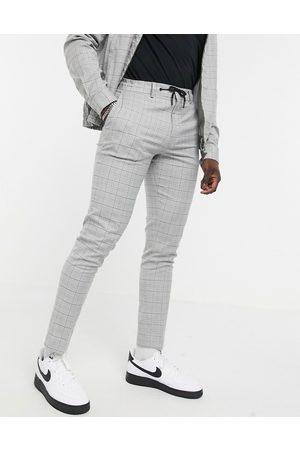 ASOS – Elegante, schmal geschnittene Hose in Grau meliertem Karomuster mit Kordelzug an der Taille