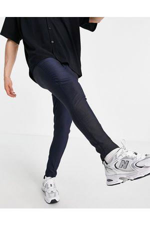 ASOS – Elegante, schmal geschnittene Hose in Marineblau mit Punkten