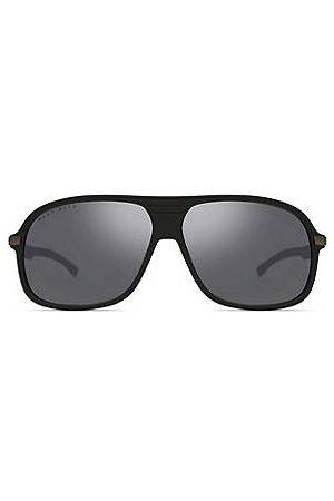 HUGO BOSS Schwarze Sonnenbrille mit breiter Fassung und gemusterten Bügeln