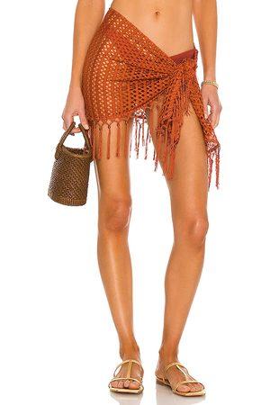Camila Coelho Vera Wrap Skirt in . Size XXS, XS, S, M, XL.