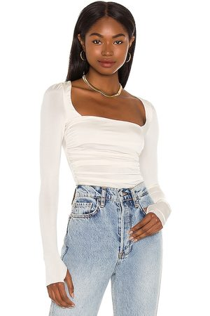 Free People Wind Down Layering Top in . Size XS, S, M, XL.