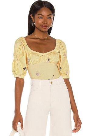 Free People Play Date Bodysuit in . Size XS, S, M, XL.