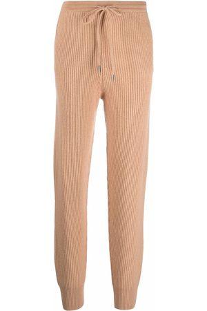 JONATHAN SIMKHAI Ribbed-knit track pants - Nude