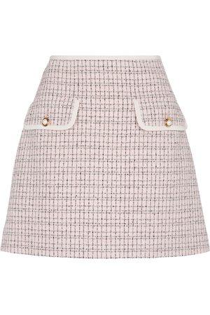 Miu Miu Minirock aus Tweed und Denim
