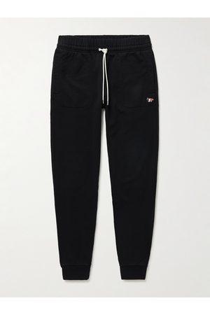 Maison Kitsuné Herren Jogginghosen - Tapered Logo-Appliquéd Cotton-Jersey Sweatpants