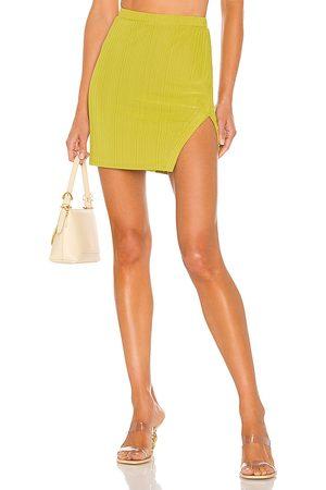 Camila Coelho Bennie Mini Skirt in . Size XXS, XS, S, M, XL.