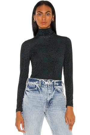 Camilla Jersey Turtleneck in . Size XS, S, M.