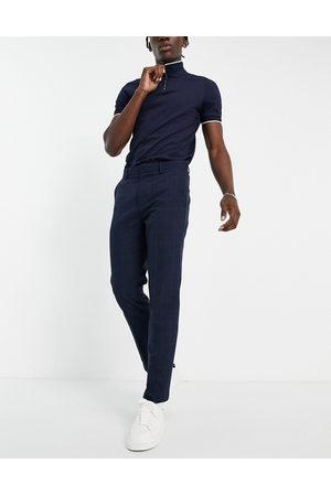 Burton Burton – Schmal geschnittene, karierte Hose in Marineblau und Grün