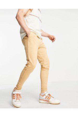 ASOS – Eng geschnittene Jogginghose aus Bio-Baumwolle in , Kombiteil-Neutral