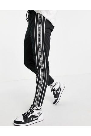 The Couture Club – Trainingsjogginghose in mit Zierstreifen