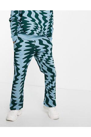 ASOS Herren Sweatshirts - – Oversize-Kapuzenpullover mit durchgehendem Zickzackmuster, Kombiteil-Mehrfarbig