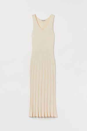 H&M Kleid mit Plisseerock