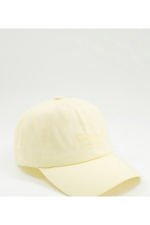 Reclaimed Inspired – Kappe in Pastellgelb mit Schriftzug-Logostickerei