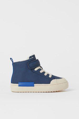 H&M Sneaker mit Teddyfutter