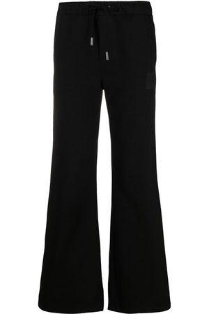 Opening Ceremony Damen Lange Hosen - Ausgestellte Jogginghose mit Logo