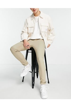 ASOS – Superenge Chinohose in -Neutral