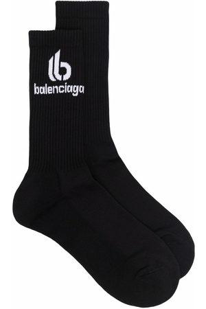 Balenciaga Herren Socken & Strümpfe - Gerippte Socken mit Logo-Print