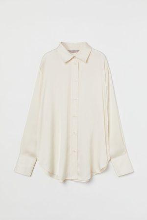 H&M Glänzende Bluse