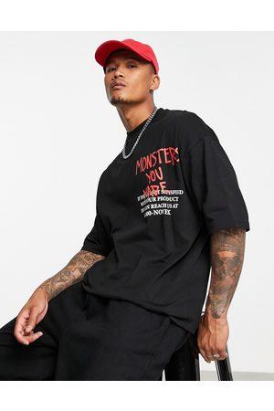 "ASOS – Oversize-T-Shirt in Schwarz mit ""Burna Boy""-Print"