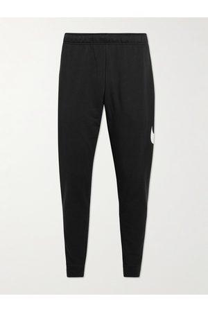 Nike Herren Jogginghosen - Slim-Fit Tapered Logo-Print Dri-FIT Sweatpants