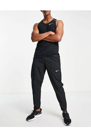 Nike – Challenger Dri-FIT – Gewebte Jogginghose in