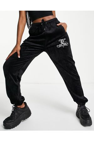 Juicy Couture – Jogginghose aus Velours in mit anliegenden Knöchelbündchen, Kombiteil